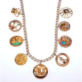 Oversize gold charm necklace, including Cartier