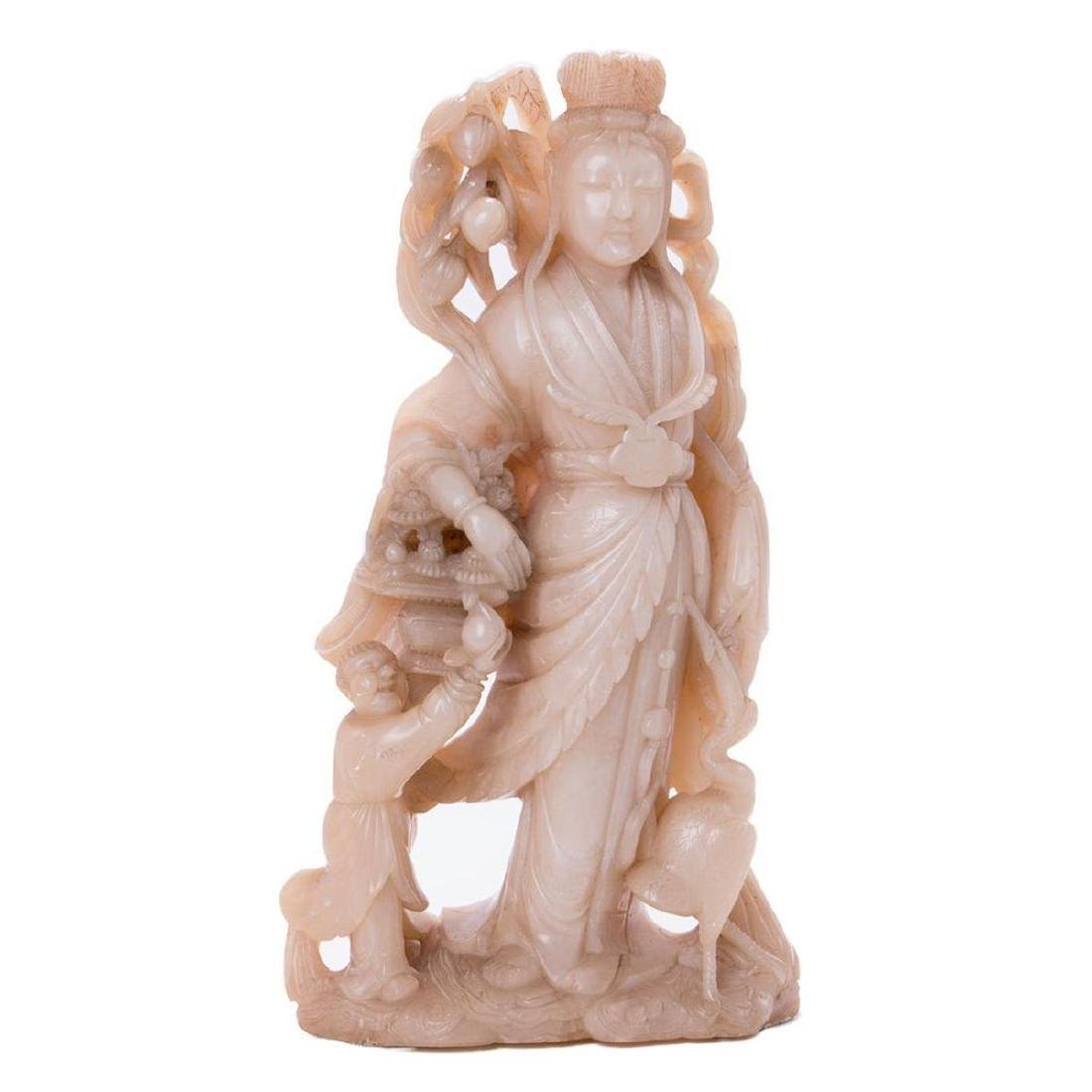 A large Chinese stone carving of a goddess.