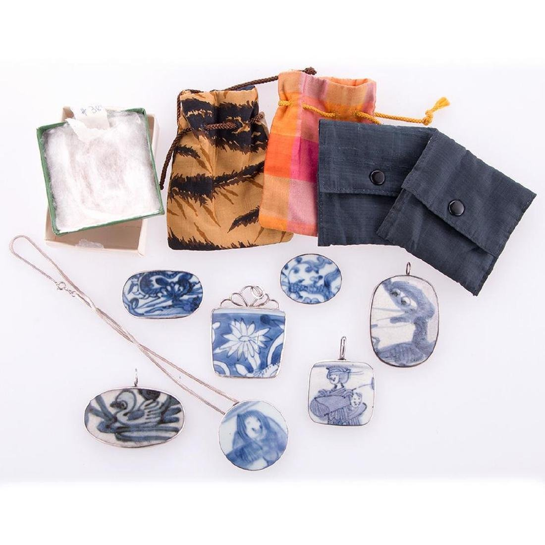 Collection of Asian pendants and purses.