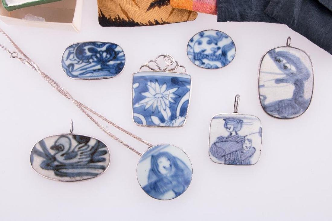 Collection of Asian pendants and purses. - 2