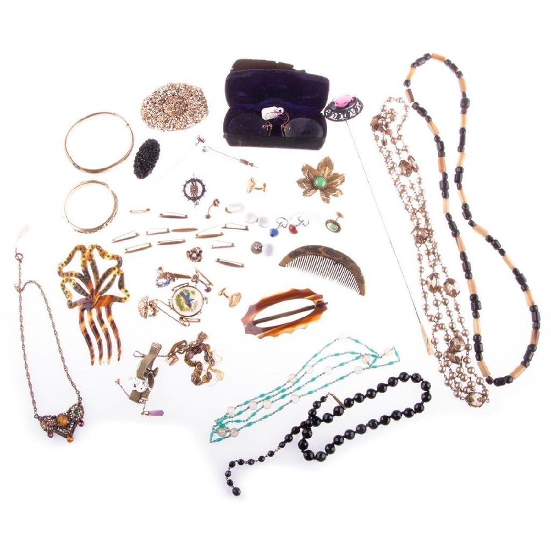 Collection of vintage costume jewelry and objects