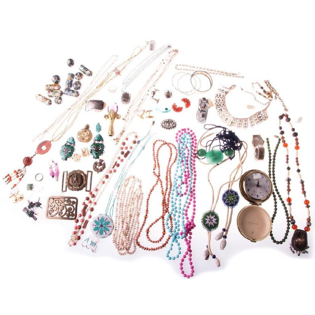 Collection of costume jewelry and assorted items