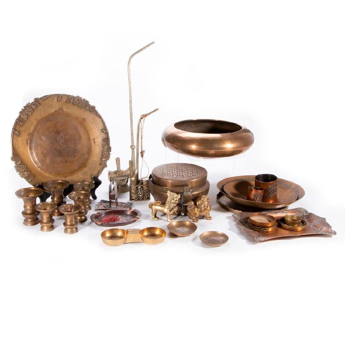 A collection of various antique metal objects.