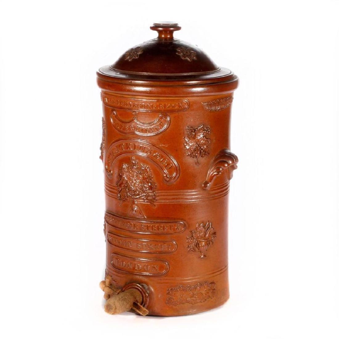 A 19th century English stoneware water barrel.