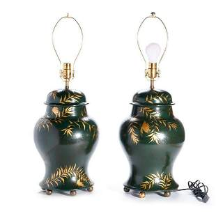 Pair of green and gilt painted lamps.