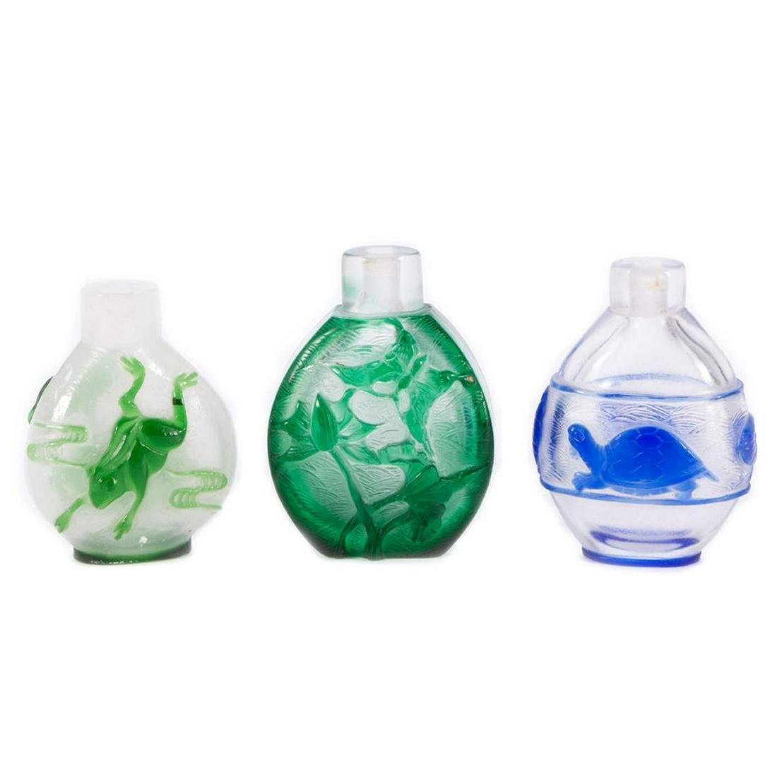 Three Peking glass snuff bottles.