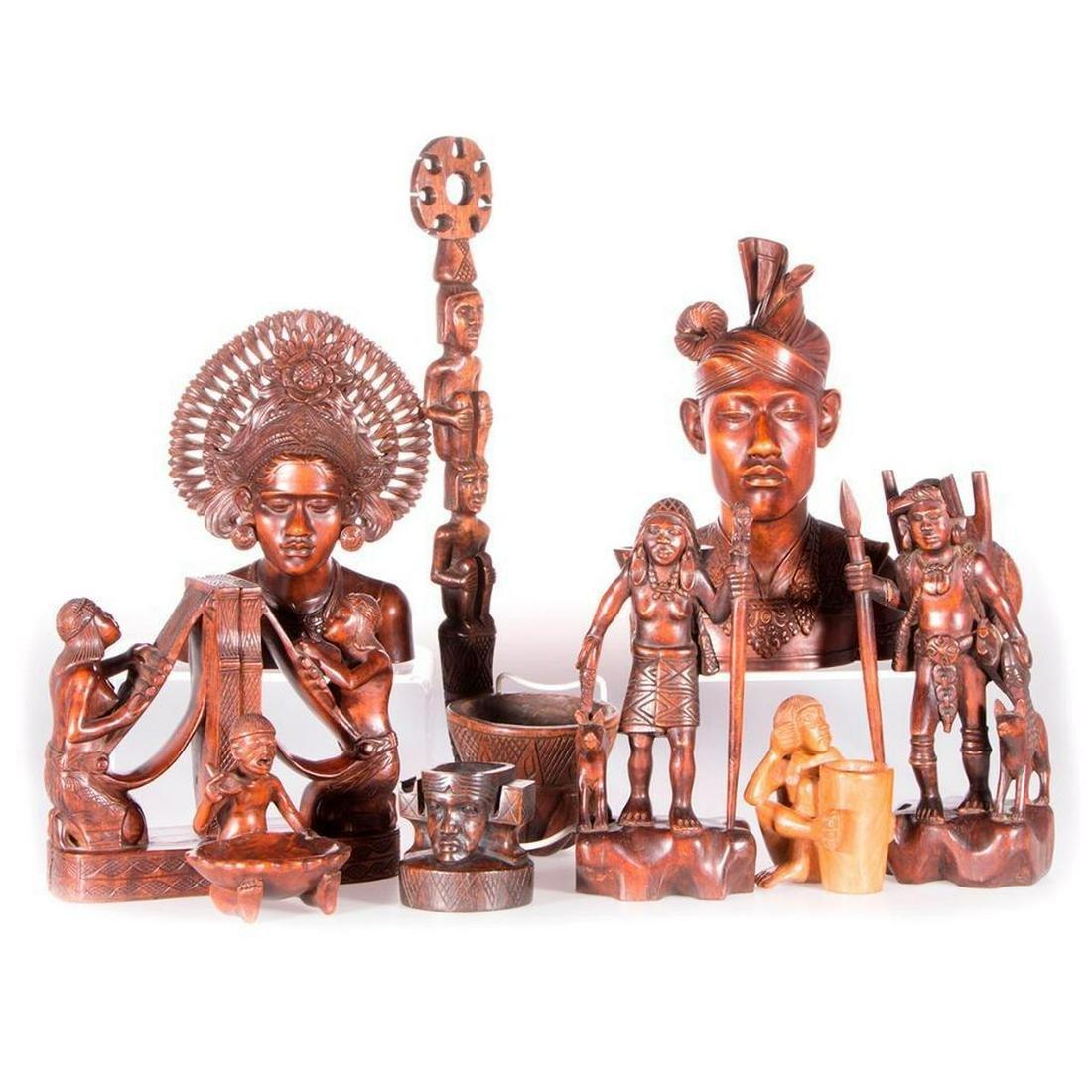 Ten Indonesian wood carvings.