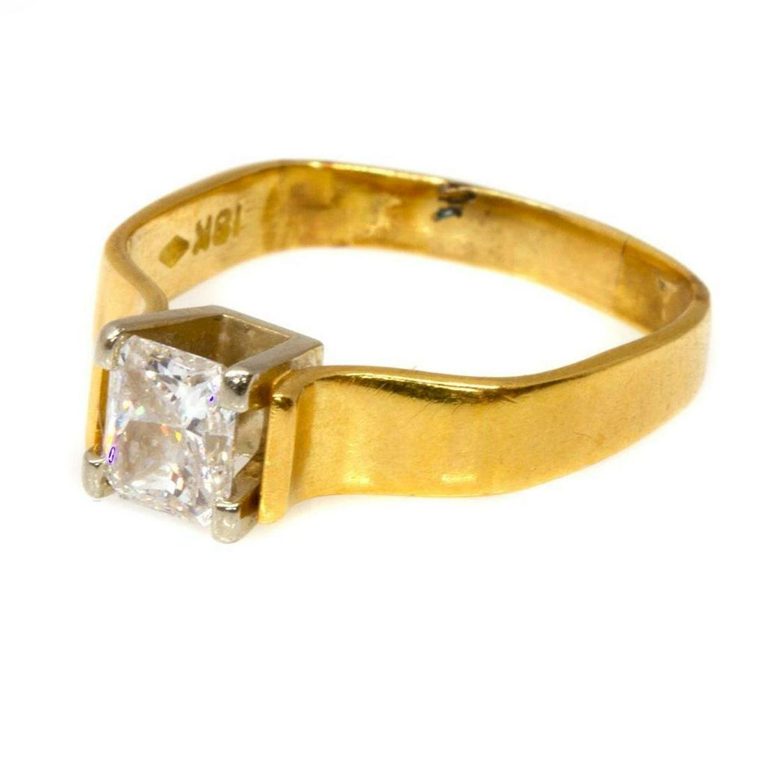Diamond & 18k gold solitaire ring