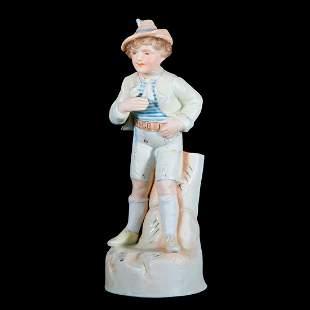 A porcelain boy vase