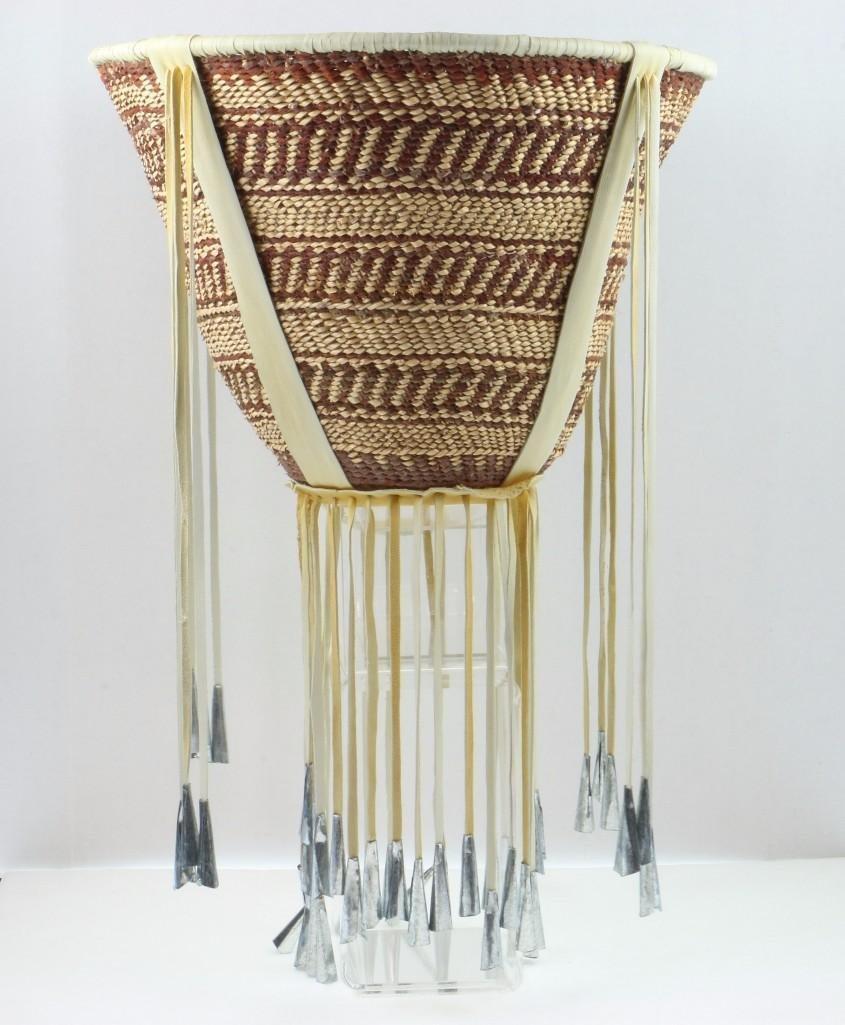 A Hopi plaque and an Apache burden basket