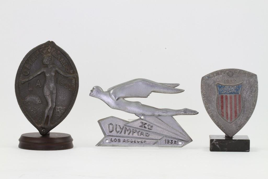 THREE 1932 LOS ANGELES OLYMPICS GRILLE BADGES