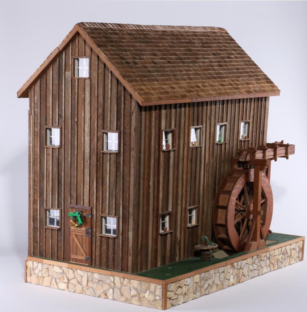 Museum exhibited doll house with working water wheel, p