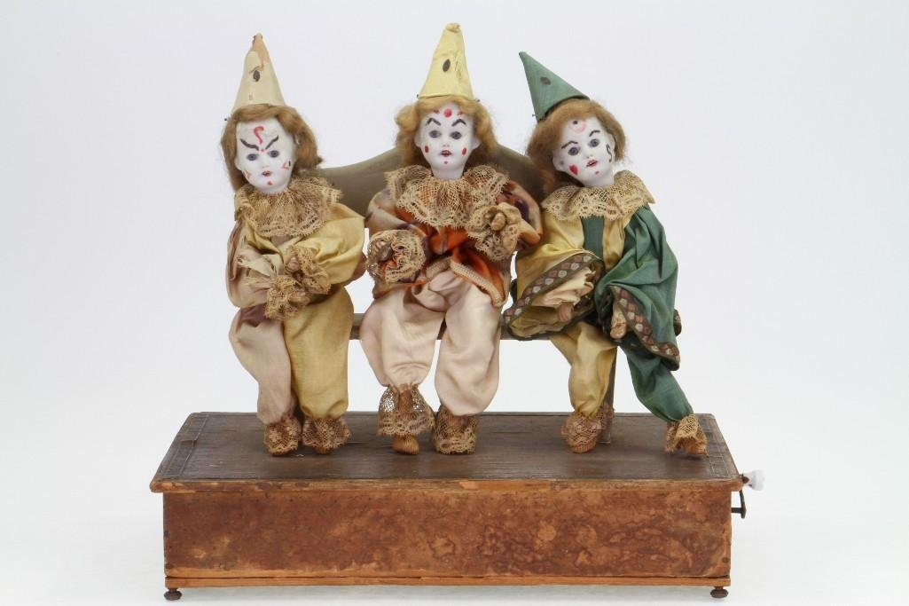 (3) Clowns Sitting on a Bench
