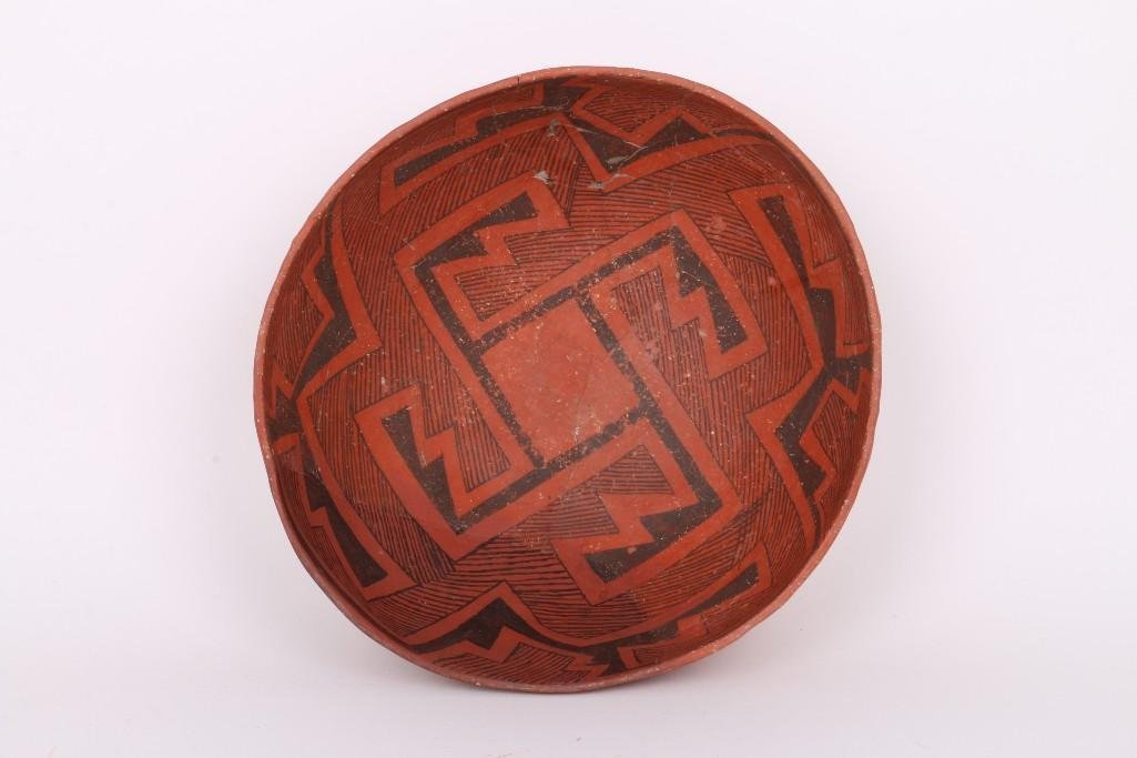 A Wingate black-on-red bowl