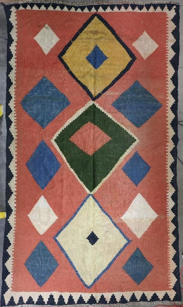 An Afghani room-sized kilim rug