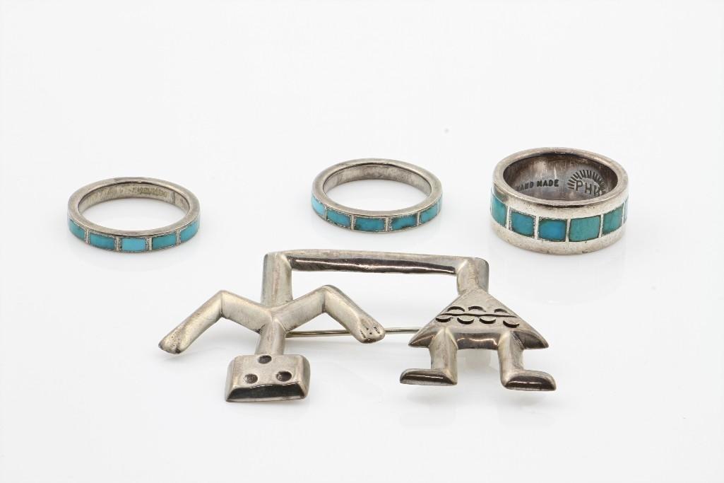 Four Southwest jewelry items