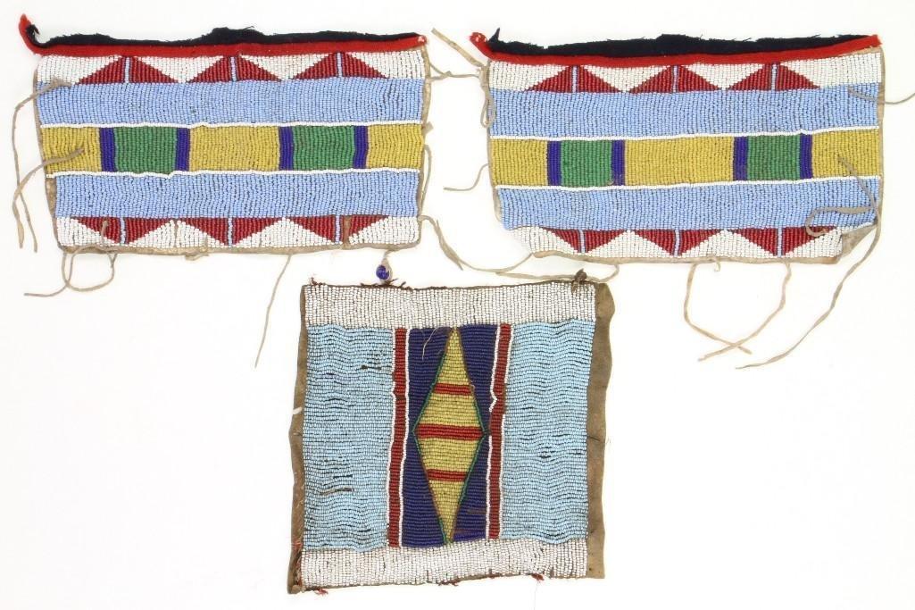 Pair of Crow/Plateau beaded armbands and a Crow bag pan