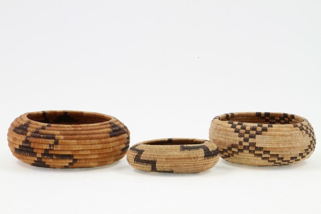 Three Pomo baskets