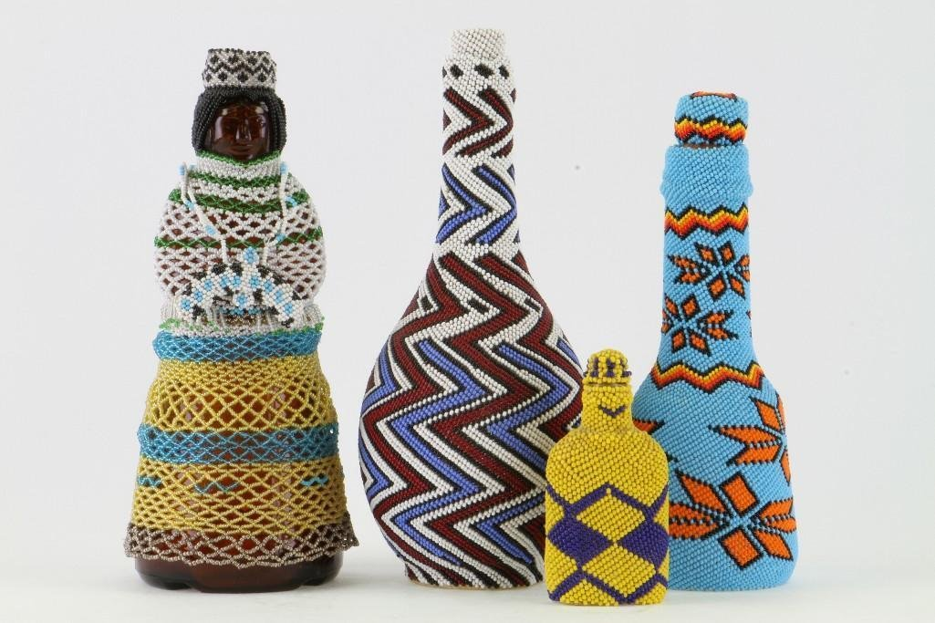 Four beaded glass containers