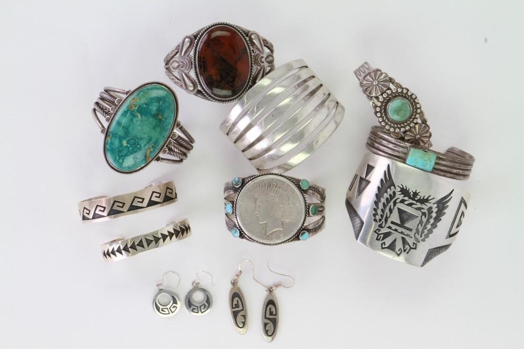 Collection of Navajo and Hopi bracelets and earrings