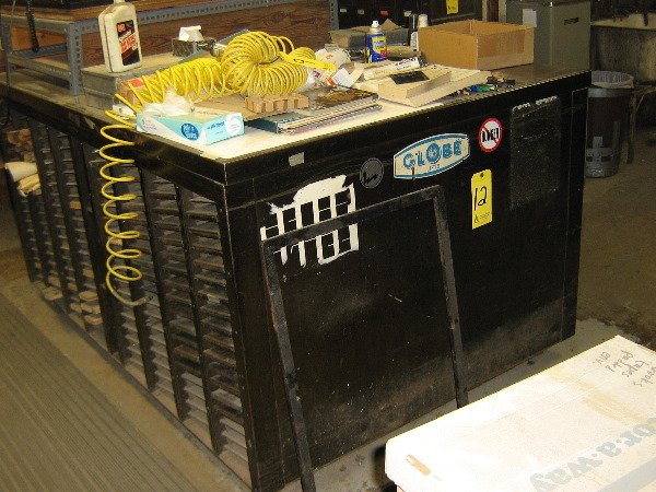 12: Thompson cabinet, imposing table, 51x78 w/galleys