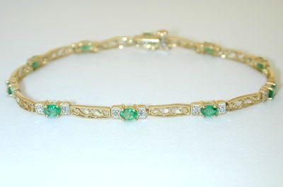 8012: 14K Gold Bracelet w/ Emerald