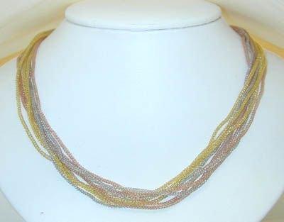 8022: 14K TRICOLOR Gold 9 Strand Necklace