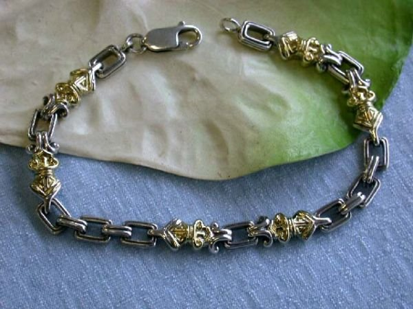 7509: Silver and 18k Gold Bracelet
