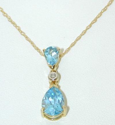8522: 10K Gold Necklace w/Diamonds/Blue Topaz Pendant