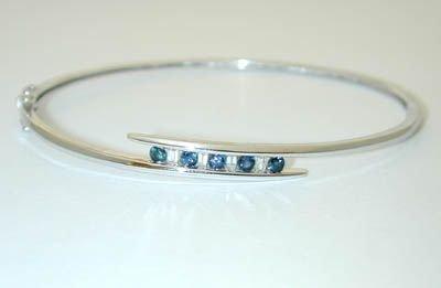 8524: 10K White Gold Diamonds Bangle w/Sapphires