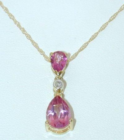 8528: 10K Gold Necklace w/Diamonds/gem stone Pend