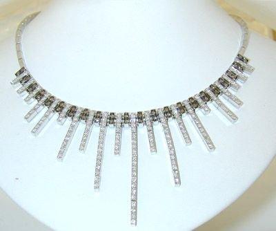 8763: Gubelin 18KW Gold Diamond Necklace