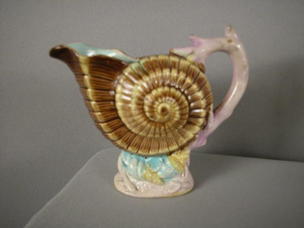 507: Majolica Figural shell creamer with coral base and