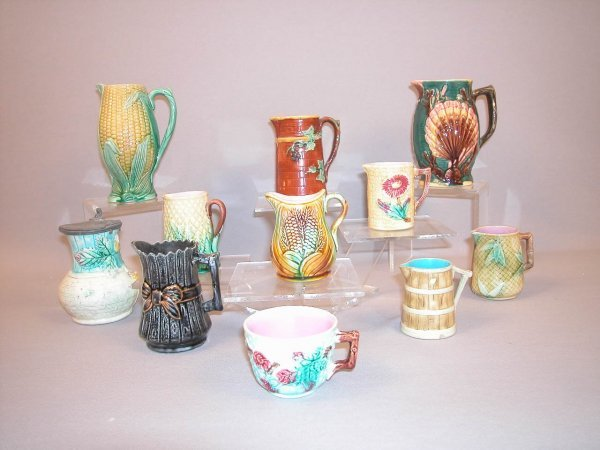 19: Majolica Lot of 10 creamers & pitchers AND one cup,