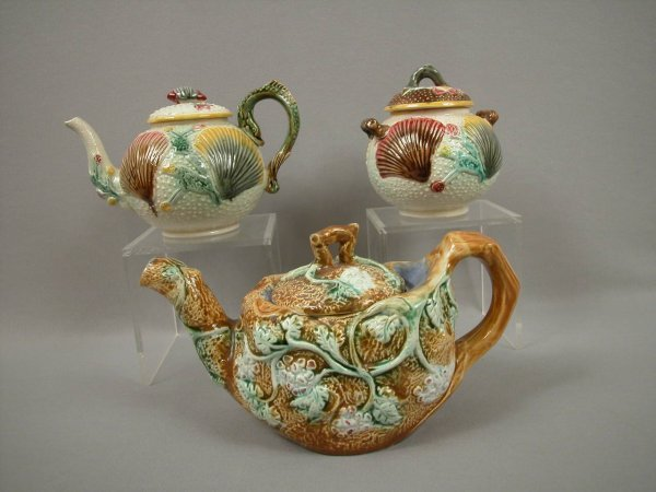 21: Majolica Two majolica teapots and covered sugar - s