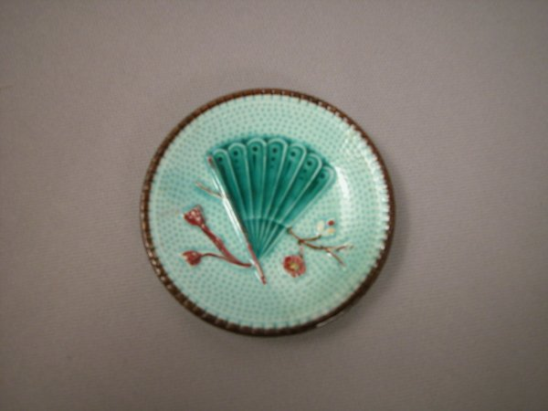 412: Majolica Continental round butter pat with turquoi