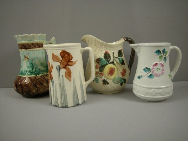 13: Lot of 4 majolica pitchers, various condition