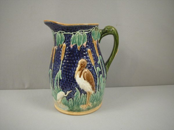 21: Cobalt stork and bullrush pitcher with swan handle,