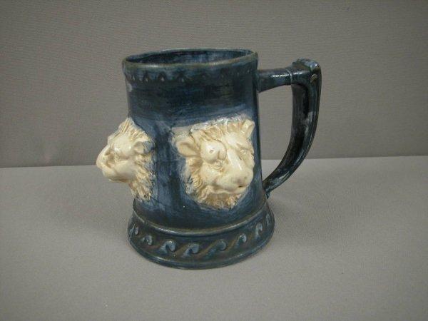 23: Cobalt majolica style mug with 3 large lion heads i