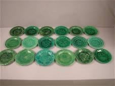 85: Lot of 18 dark green majolica plates, various patte