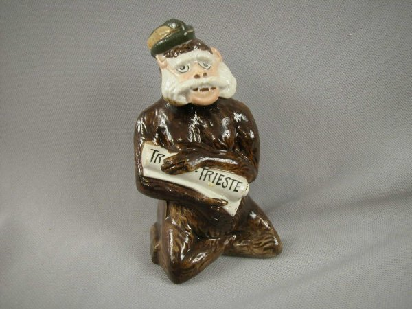 523: French figural ceramic still bank in the form of a