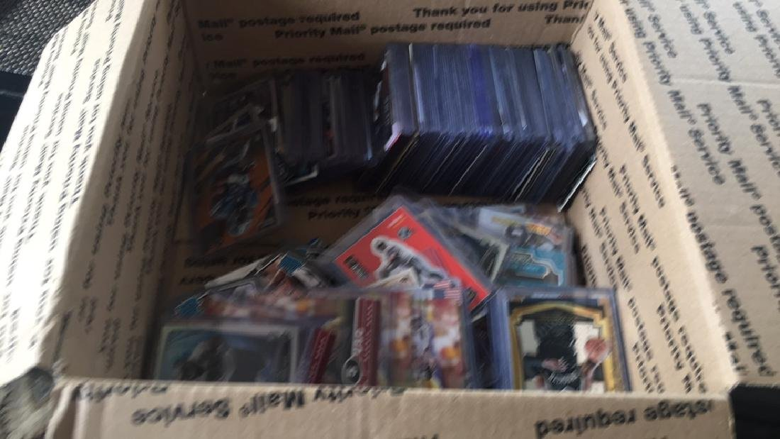 Huge box of sports cards filled with stores and