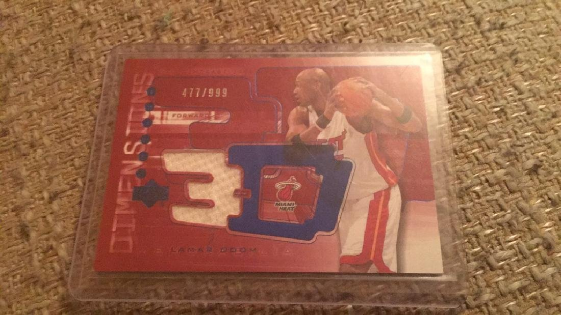 Alonzo Mourning triple dimensions jersey card