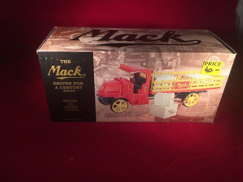 The Mack model AC Stake truck