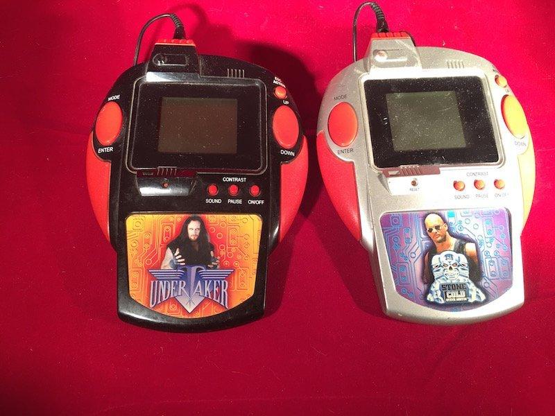 Lot of 2 WWE wrestling handheld games