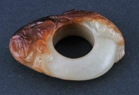 Jade Archers ring. China. 18th century. White stone
