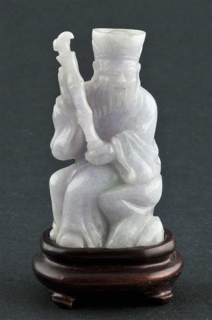Jade carving. China. 20th century. Lavender stone with