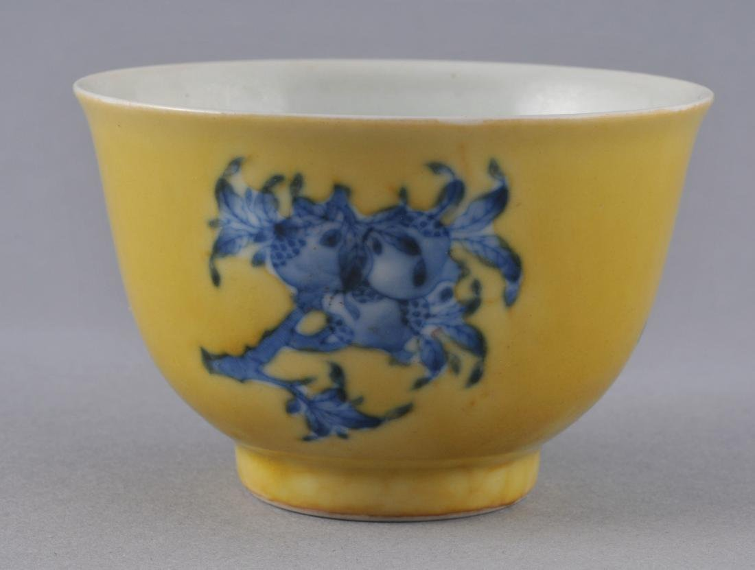 Porcelain cup. China. Early 20th century. Yellow ground