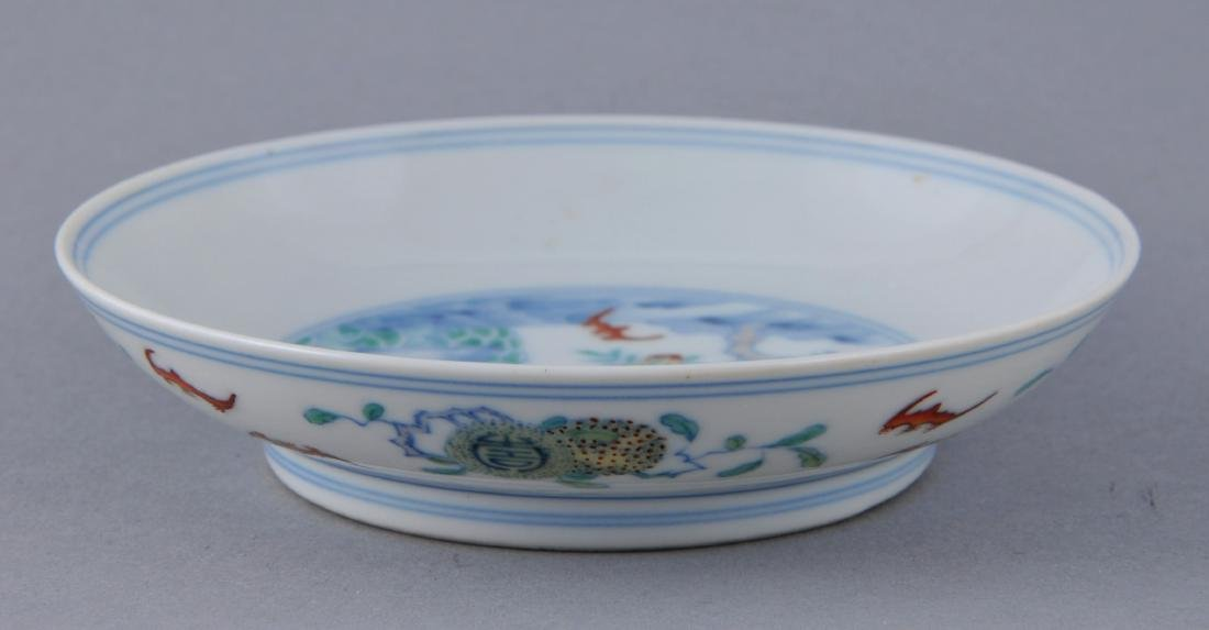 Porcelain saucer dish. China. Early 20th century. Tou