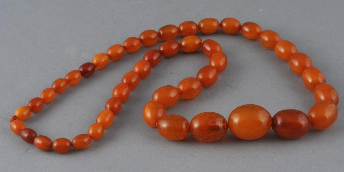 Set of graduated amber beads. Honey colored.